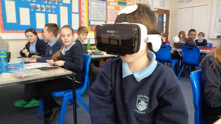 High Down Junior School pupils wore virtual reality headsets so they could 'explore' the moon.