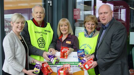 Sharon Benjamin and Craig Helps from Reeds Rains Clevedon at the foodbank collection point with Sain