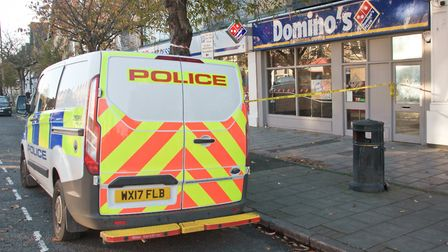 Police scene of crime tape and police vehicle outside Domino's Pizza in the Boulevard.