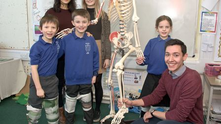 Bristol University students with pupils, looking at bones and joints and how they work.