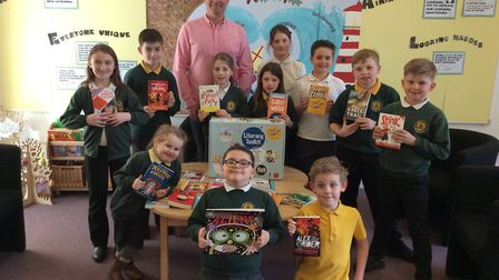 Trinity Primary School pupils with their books.