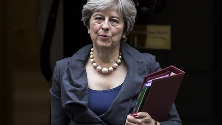 Prime Minister Theresa May leaves 10 Downing Street to attend the weekly Prime Ministers Questions.