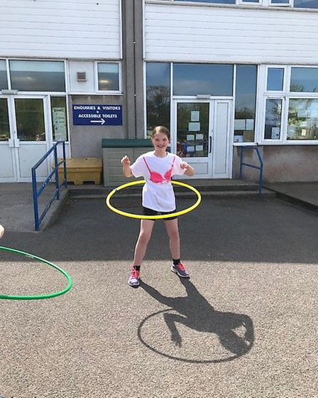 Zoe taking part in the hula hoop challenge.