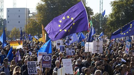 Demonstrators hold placards and European Union flags as they take part in a march calling for a Peop