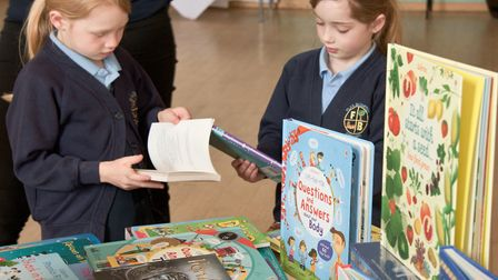 Flax Bourton Primary School pupils looking at the books they helped raise money for with a sponsored