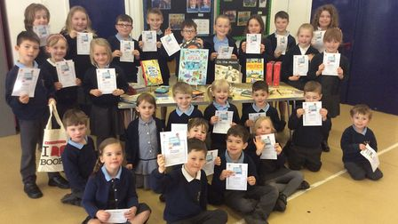Pupils from Mary Elton Primary School with some of their new books.