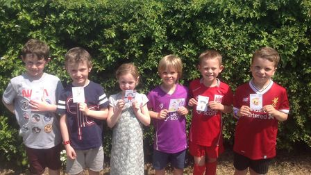 Pupils with stickers for the Flaxini Sticker Book.