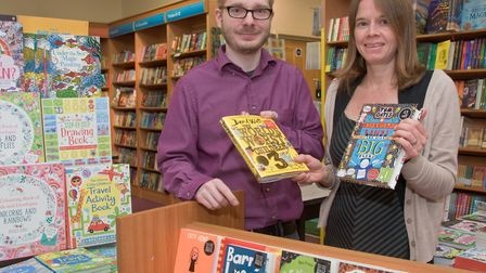 Waterstones book store. Reporter Vicky Angear with manager Chris Ashford picking up Books For School