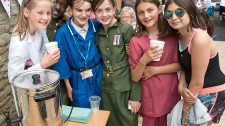 """Children from All Saints Primary School dressed as their heroes organising a """"Big Brew"""" for SSAFA."""