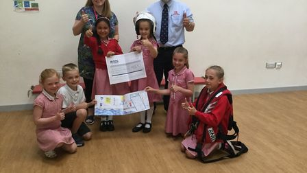 Pupils handing the cheque to Portishead RNLI.