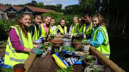 Students gardening at Children's Hospice South West's base in Charlton Farm.