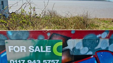 For Sale signs on the hordings around the Royal Pier Hotel site.