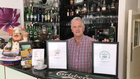 Steve Williams with two of the certificates.