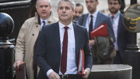 Brexit secretary Stephen Barclay leads his team out of his office including Attorney general Geoffrey Cox. Photograph...