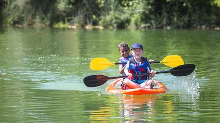 Children can try kayaking in safe conditions at a summer club. Picture: Getty Images/iStockphoto