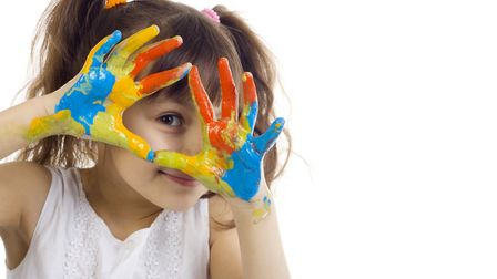 Computer games are all very well, but kids still love getting messy fingerpainting. Picture: Getty I