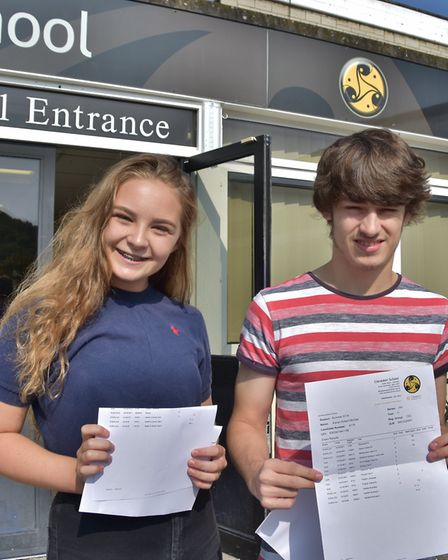 Youngsters smile for the camera after picking up their results. Picture: Mike Thie