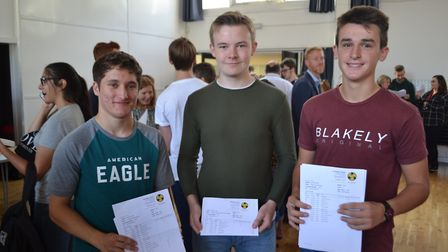 Students smile after opening their GCSE results. Picture: Eleanor Young