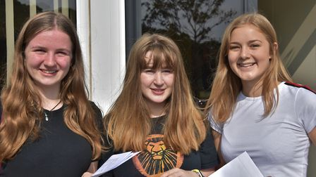 Students flash a smile after picking up their grades. Picture: Mike Thie