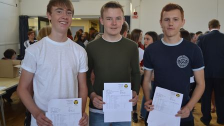 Alfie Langson, Ben Shortman and Thomas Down show off their GCSE results. Picture: Eleanor Young