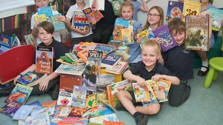 Crockerne Primary School pupils receiving books from the Books For Schools campaign.