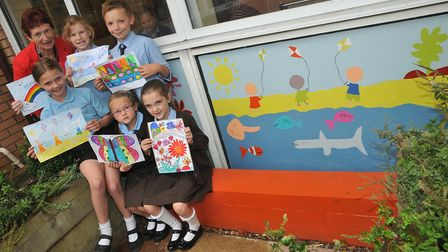 Vice chair of governors Mrs Pauline Tillet with the children whose artwork was chosen.Picture: Jerem