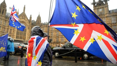 Anti Brexit supporters in the rain in Westminster. Photograph: Kirsty O'Connor/PA Wire