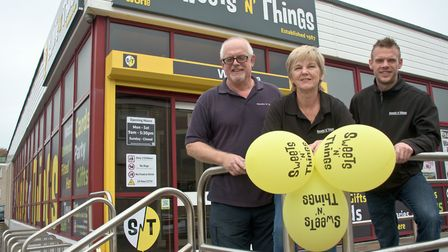 Chris Richards and parents outside Sweets 'n' Things at the old Worle library building in The Maltin