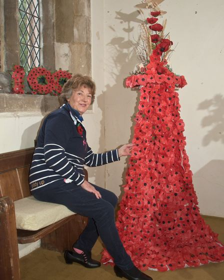 Marion Green and her floral display for WW1 centenary at Wick St Lawrence Church. Picture: MARK A