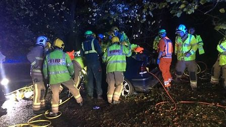 Fire crews working to free a man from his car after he collided with a tree. Picture: Avon Fire and