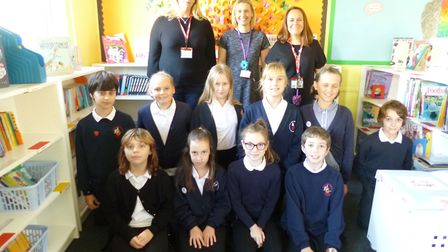 Staff and pupils in the newly refurbished library.