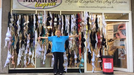 Tanya with the bras donated at Moonrise Lingerie.