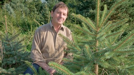 Michael Russell, from Christon, with the Christmas trees he used to build a lodge in Ethiopia. Pi