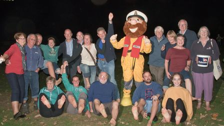 Winscombe branch of the RNLI fundraising with a fire walk.
