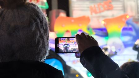 Member of the public capturing the brightly decorated floats. Picture: Emma McGladdery (iwitness24)