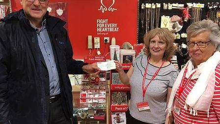 Bleadon Players present a cheque to the British Heart Foundation.