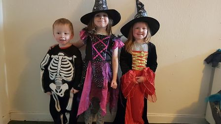 Four-year-old skeleton Riley Chrisp and witches Sophie, aged six and Ruby, aged five.