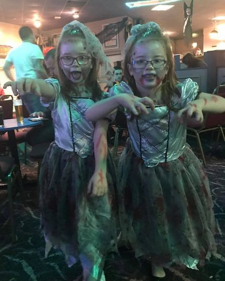 Six-year-old zombies Maisie and Ellie King.