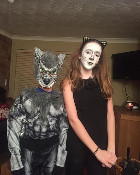 Nine-year-old wolf Joe Rossiter and cat Amy, aged 13.