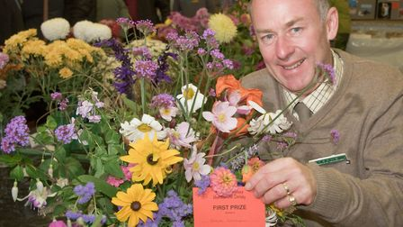 Steve Clampin with some flowers from his garden at Yatton Autumn Show. Picture: MARK ATHERTON
