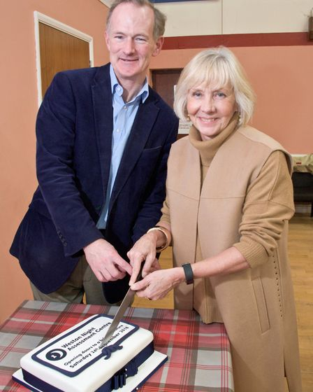 Weston MP John Penrose with Cllr Catherine Gibbons cutting the cake to mark the opening of the Night