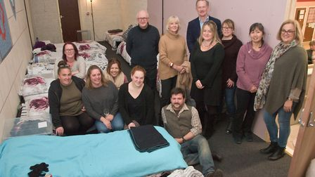 Workers and volunteers with special guests at the official opening of the Weston Night Assessment Ce