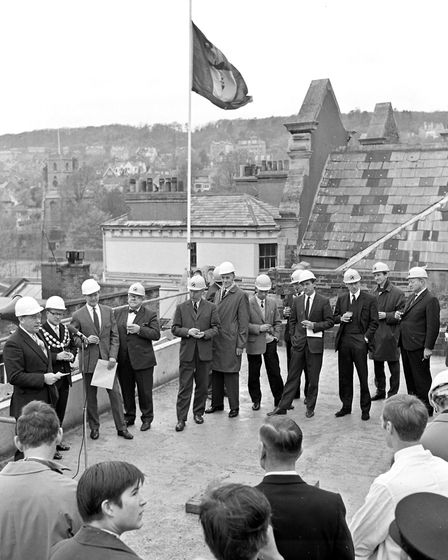 Weston's Mayor, Cllr Peter Hess, completing the topping out ceremony on the roof of the new Weston P