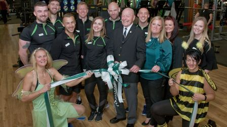 Terry Hornet, cutting the ribbon, and general Manager Sarah Matthews, with her staff at Nuffield Hea
