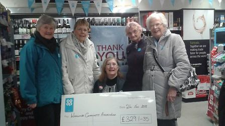 The team from Winscombe Community Association with Co-op manager Sue Wells. Picture: Sub
