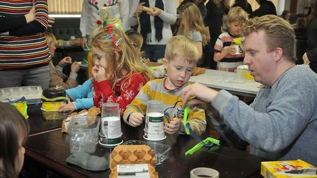 Making Hats at the Story Cellar Christmas Carol event at Pill Memorial Club. Picture: Jeremy Long
