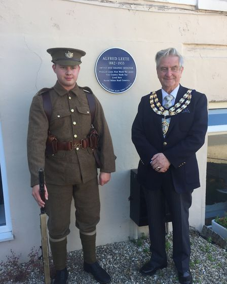 World War One re-enactor Josh Cottrell dressed as a member of Kitchner's Army, and mayor Mike Lyall.