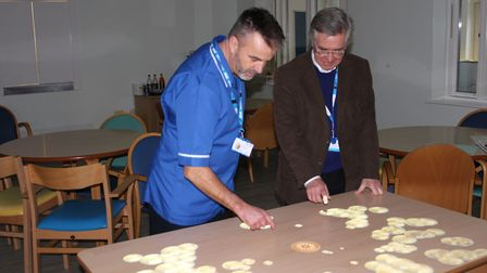 Staff nurse Nigel Pedley and non-executive director Malcolm Shepherd using the table.