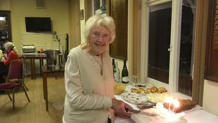 Clarice Coulson cutting her 100th birthday cake.