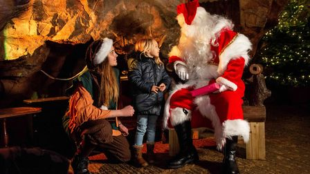 Santa handing out gifts in Cheddar's caves. Picture: CHEDDAR GORGE AND CAVES/LONGLEAT